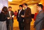 Mr. Xing Dezhang exchanges cards with attendees